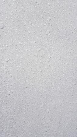 Water droplets on the white wall Stock Photo