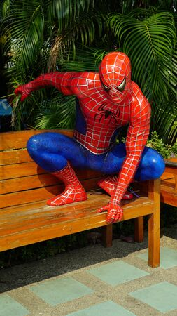 CHACOENGSAO,THAILAND - FEBRUARY 02, 2019: Spider-Man model sitting on wooden chairs in the Wat Samanrattanaram temple area