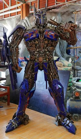 CHACHOENGSAO, THAILAND - FEBRUARY 02, 2019: The Replica of Optimus Prime robot made from iron part of a Car is shown in the Wat Saman Rattanaram temple area