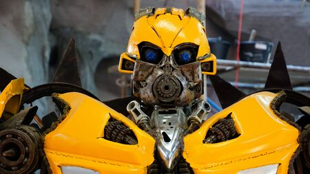 CHACHOENGSAO, THAILAND - FEBRUARY 02, 2019: The Replica of Bumblebee robot made from iron part of a Car is shown in the Wat Saman Rattanaram temple area