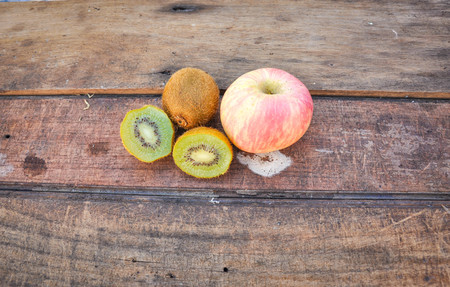 antecedents: Fruits on the wooden floor Stock Photo