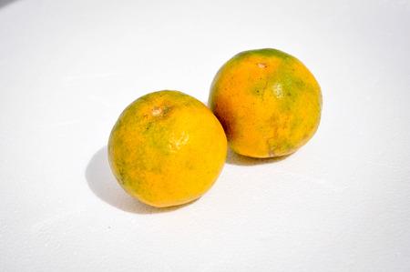 edibles: Orange on a white background.