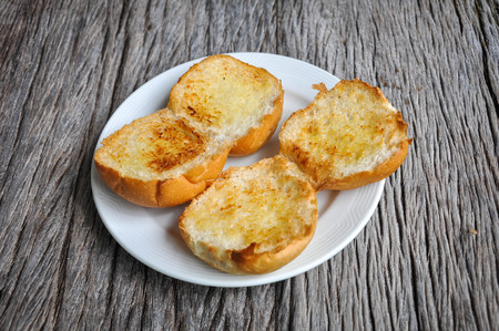 wood molding: Garlic bread on the plate.