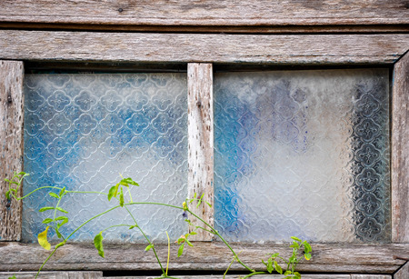 putrid: Window of a old wooden house