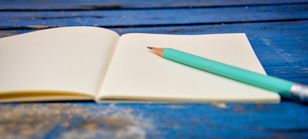 pencil and paper: Notebook on a wooden table Stock Photo