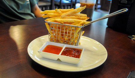 edibles: French fries in baskets for serving Stock Photo