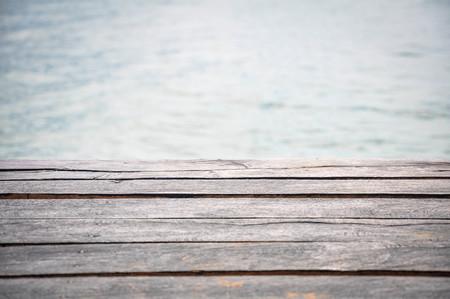 wood bridge on the sea background Stock Photo