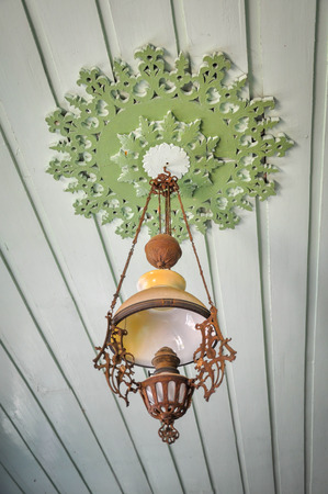 Vintage lamps on the ceiling of the house.
