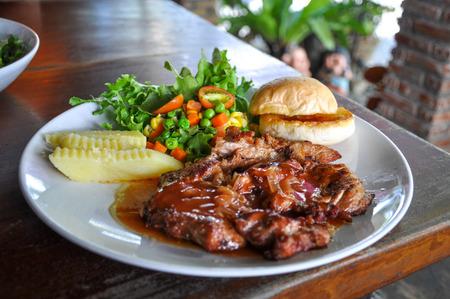 Pork steak on a white plate