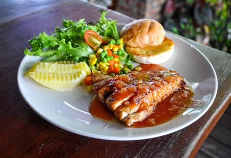 chicken steak in white dish
