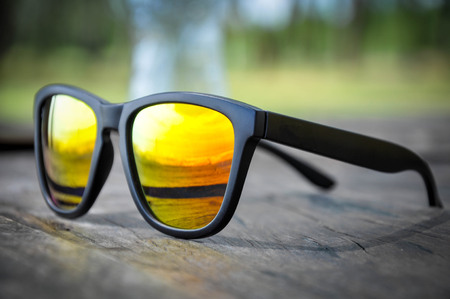 Sunglasses on old wood Stock Photo - 90761504