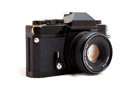 Shot of a vintage 35mm SLR camera isolated against white photo
