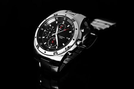tachymeter: Mens wrist watch isolated against black