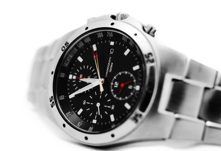 tachymeter: close up of a modern mens watch isolated againts white