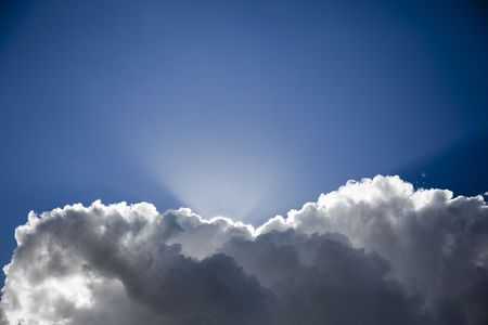 Light rays emerging from behind a cloud Stock Photo - 5905561