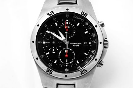 tachymeter: Close up of a mens watch isolated against white