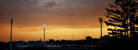 yelloow: Low angle shot of the Gabba at sunset, with the stadium lights on.