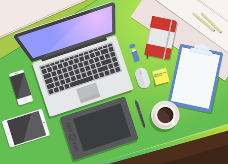 Realistic workplace organization. Flat Lay. View from above: desktop, laptop, smartphone, tablet, graphics tablet, diary, pencil, coffee mug, flash card.