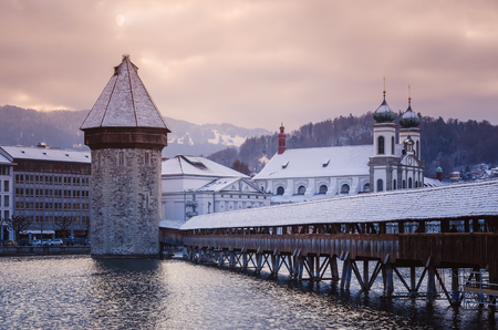 Historic city center of Lucerne (Chapel Bridge) on the Reuss, stone tower Wasserturm and domes of the Church of the Jesuits. Europe, winter Switzerland.