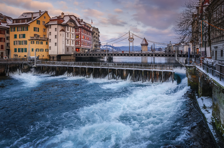 Historic center of Lucerne with Reuss. Old Swiss houses and Wasserturm Europe, Switzerland.