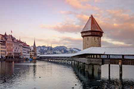 Historic city center of Lucerne (Chapel Bridge) on the river Reuss, stone tower Wasserturm. Europe, winter Switzerland.