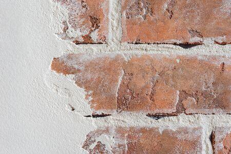 Textured horizontal background. Shabby masonry imitating an old wall. Decorative wall plaster, exterior facade decoration close-up. 免版税图像