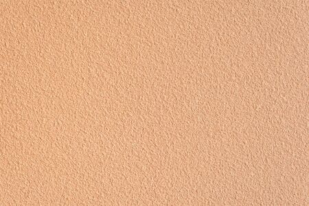 Textured sand background closeup. Decorative wall plaster, interior decoration. Background image of a wall with a beige textured coating. 免版税图像