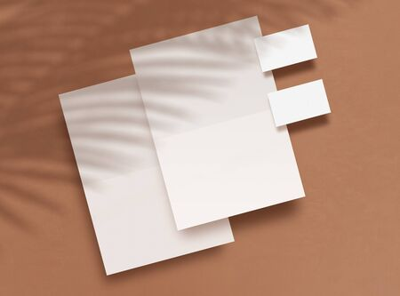 Top view of blank forms and business cards on a brown background. Shadows overlays from tropical plants. Empty objects to place your design. Corporate identity Branding Mock up. 3D illustration. 免版税图像
