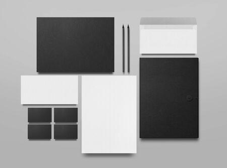 Mock up. Set of mock up elements on gray background. Blank objects for placing your design. Black folder, a sheet of paper, an envelope, a black business card and pencils. 3d illustration. Imagens