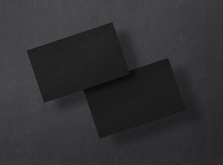 Black business cards on a black background. Mockup. Corporate templates, identity design, company style. Top view. 免版税图像