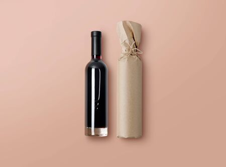 Mock-up of a bottle of red wine and bottle wrapped in craft paper on nude background. Blank objects for placing your design. 3d illustration.
