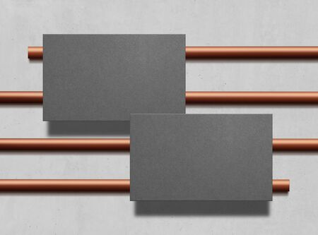 Two business cards. Mock up. Gray business cards template for your design on copper pipes background. Corporate templates, identity design, company style. Top view. Illustration. 免版税图像