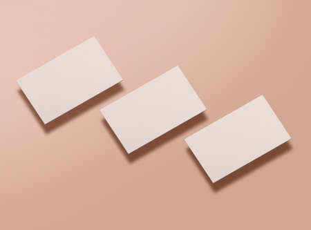 Mock up of blank business cards on nude background. Template for corporate identity. Empty objects to place your design. 3D illustration. 免版税图像