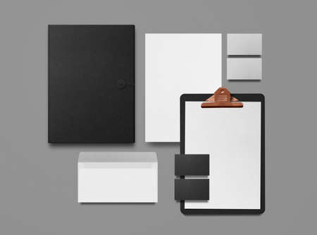 Mock-up. Clipboard with sheets of paper, business cards, envelope and folder on gray background. Template for branding identity. Blank objects for placing your design. Top view. 3d illustration.