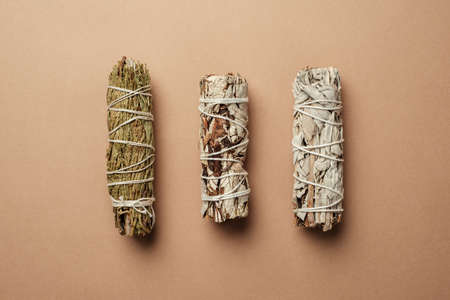 Set of incense for fumigation of premises. Branches of white sage with cedar tied in a bunch. View from above. Organic holy plant incense from Latin America. Close-up color photo. 免版税图像