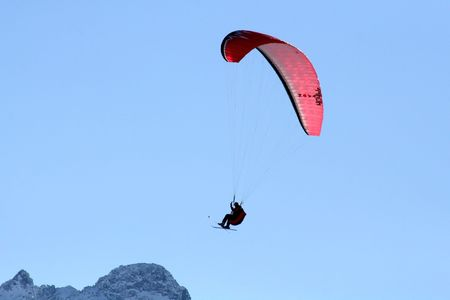 paraglide: Paraglide flying high over the mountains