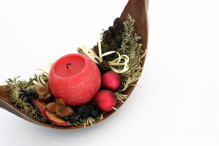 zweig: Red candle in a decorated wooden bowl Stock Photo