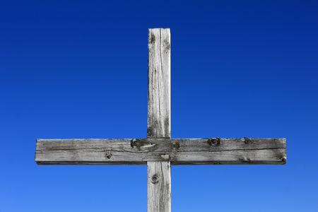 Part of a weathered wood cross on blue sky  Stock Photo