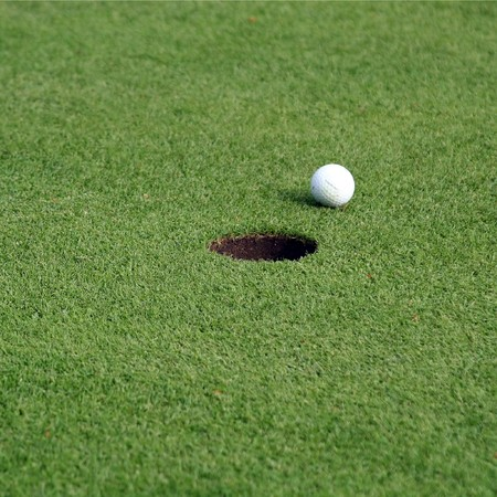Golfball in front of the hole