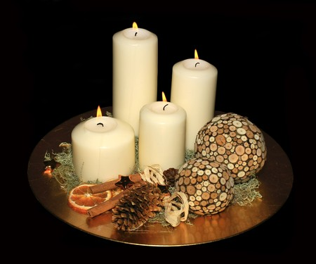 Original advent wreath with four burning candles isolated on a black background photo