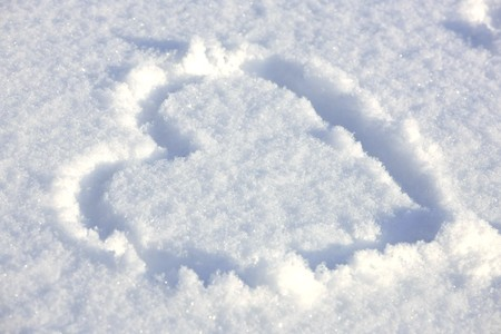 Close view of a heart signed in fresh snowflakes