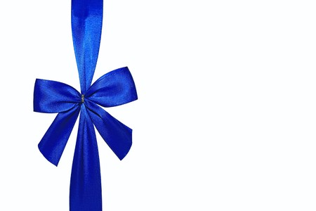 Close view of a blue bow isolated on a white background