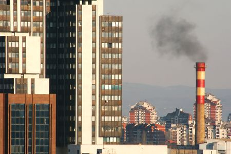 tall chimney: Urban photo of a city. Tall buildings and a chimney. Stock Photo