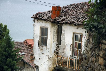 bad condition: Old house in a bad condition, overlooking a lake.