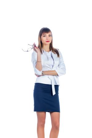 falda corta: Mujer de negocios en una falda corta con gafas Foto de archivo