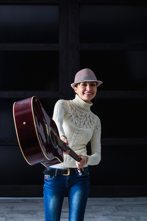 25 30: girl in the hat brandishing a guitar Stock Photo