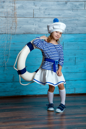 life preserver: girl standing and holding a life preserver