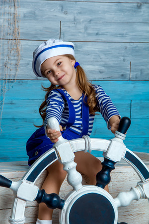 child vest sits on the chest and keep the steering wheel Stok Fotoğraf