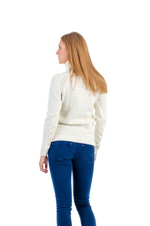 womankind: girl in a sweater and jeans on a white background