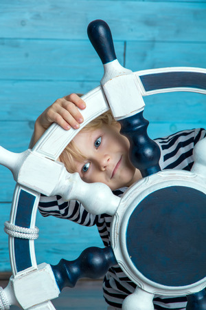 child vest looks thoughtfully through the wheel